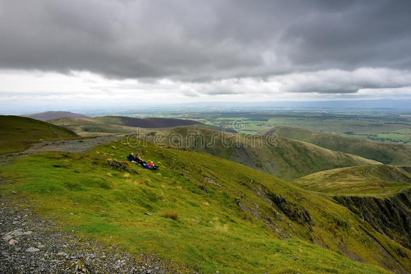 Walkers at rest on Blencathra. Walkers having a break and enjoying the views stock images