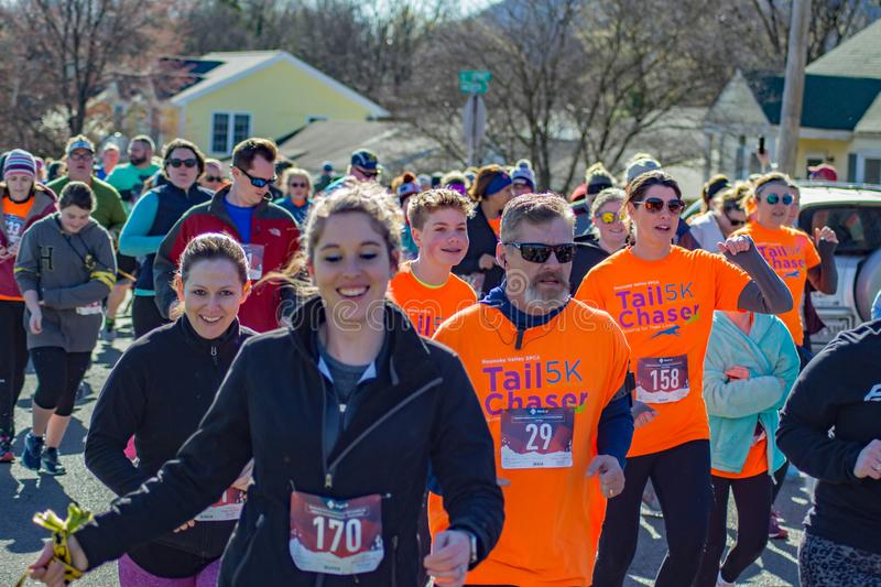 Walkers and Runners. Roanoke, VA – March 23rd: A large of group of runners and walkers at the annual Roanoke Valley SPCA 5K Tail Chaser located along the royalty free stock photos