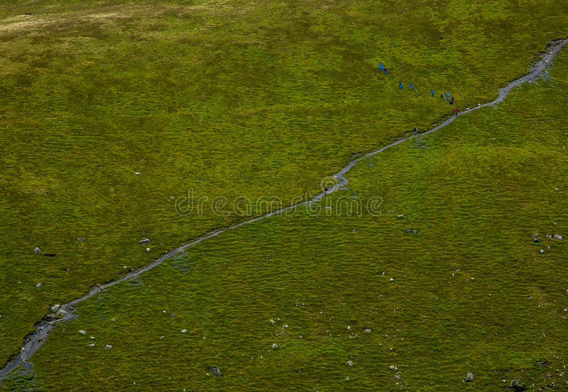 Walkers. On the side of blencathra stock photography