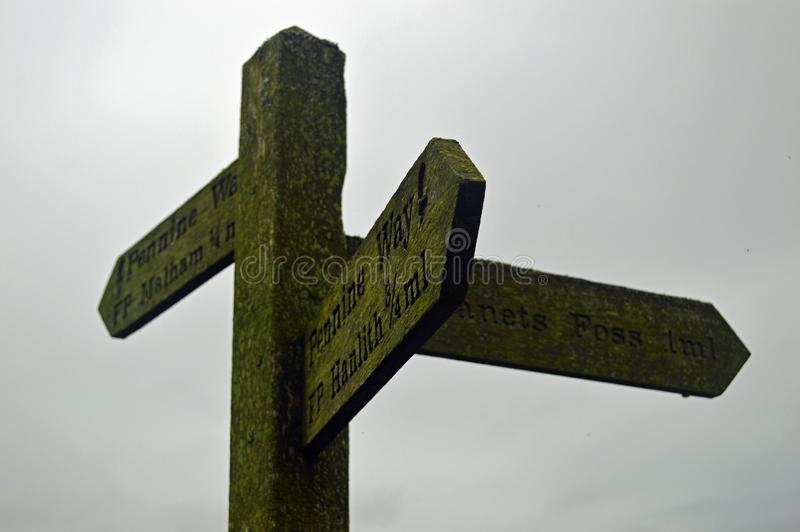 Walkers Signpost Yorkshire Dales National Park. Old fashioned sign post for walkers, yorkshire dales national park signing the way to many of the areas tourist stock images