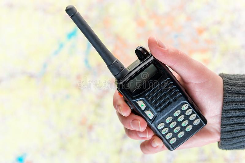 Walkie talkie in the background on the map - concept search for. The missing people volunteering royalty free stock photography