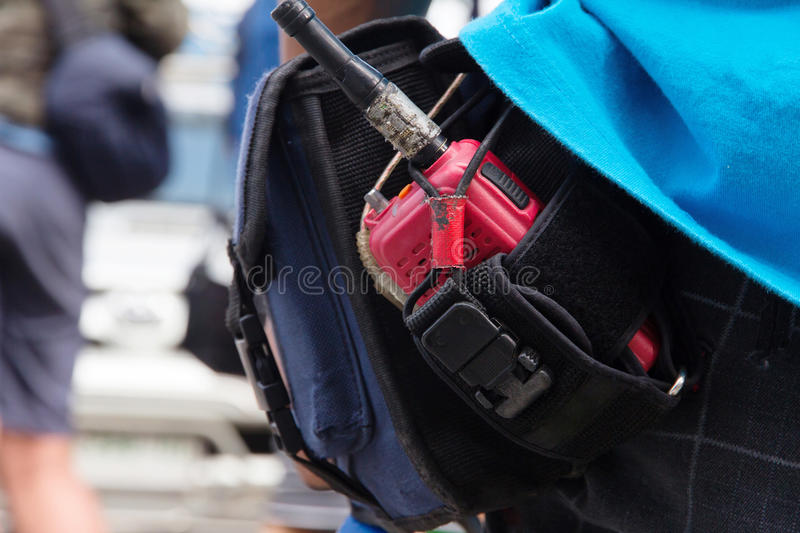 Walkie talkie. Close-up of male with Walkie talkie stock image