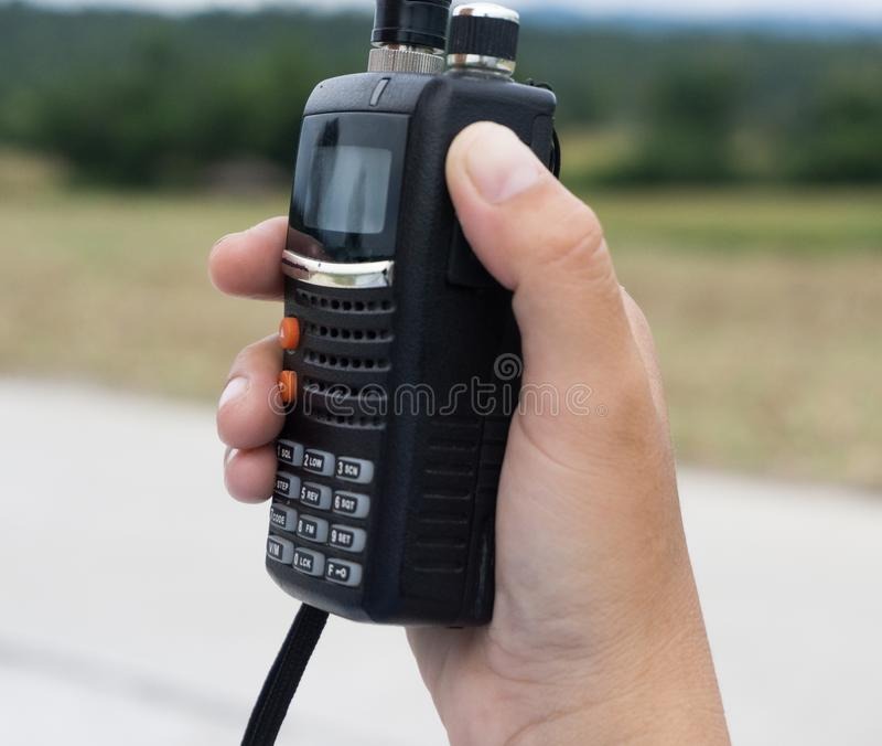 Walkie-talkie radio in hand.  stock photography