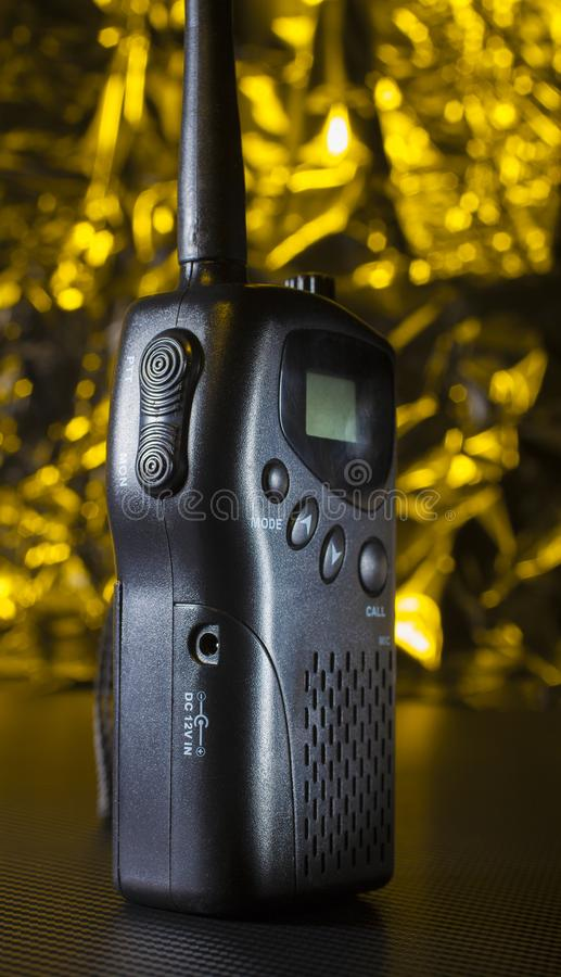 Walkie-talkie on yellow. Walkie-talkie for very high frequency transmissions with yellow behind royalty free stock images