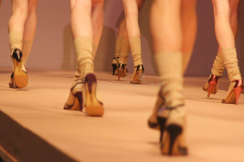 Walking. Model walking on path - fashion week show in Milan