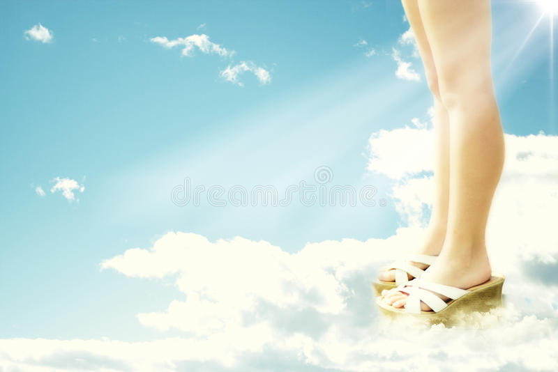Walking on air. Conceptual, standing on clouds and walking on air, added noise royalty free stock photo