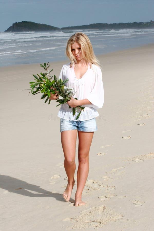 Walking along beach royalty free stock photo