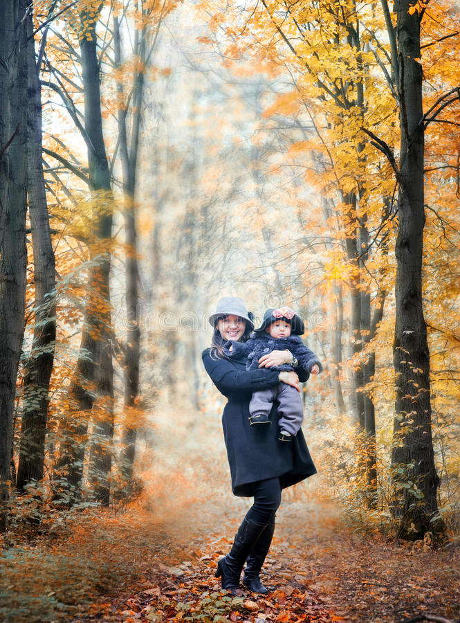 Walking in an autumn park royalty free stock photo