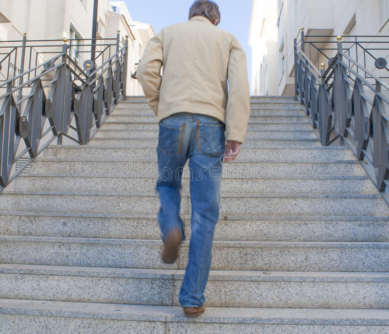 Walking away. A man walking away up some steps royalty free stock images