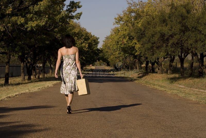 Walking away brunette stock photo