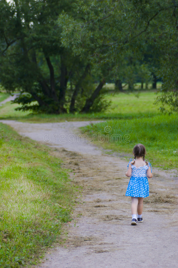 Walking away kid royalty free stock photography