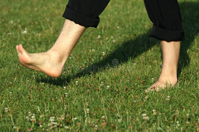 Walking barefoot stock photo