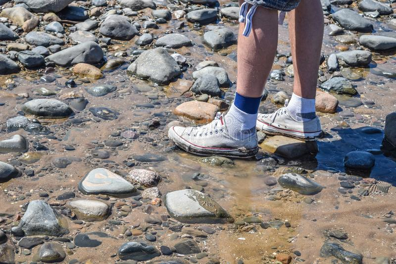 Walking on the beach in Blackpool. stock images