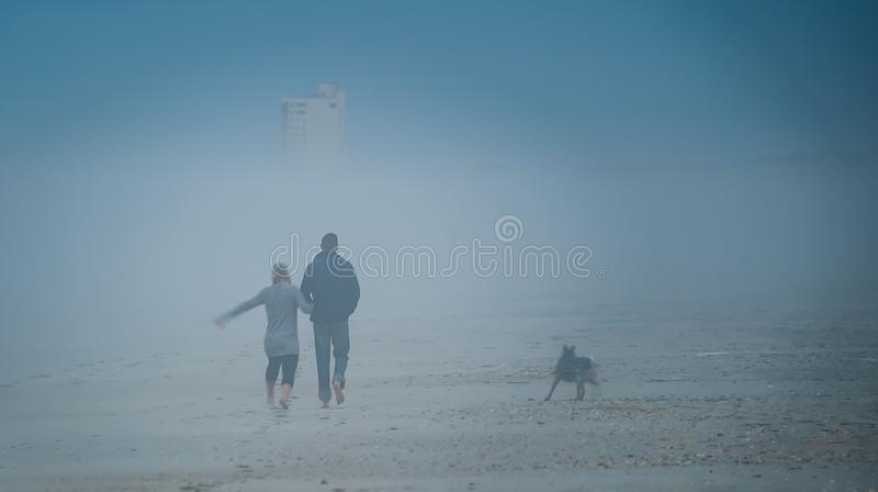 Walking on the beach royalty free stock photos