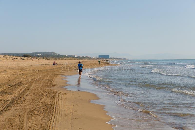 Walking on beach between La mata and Guardamar de Segura Costa Blanca Spain. Costa Blanca beautiful natural beach between Torre La mata and Guardamar de Segura royalty free stock image