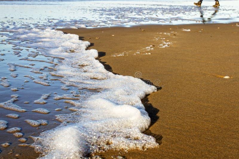 Walking on the beach stock photos