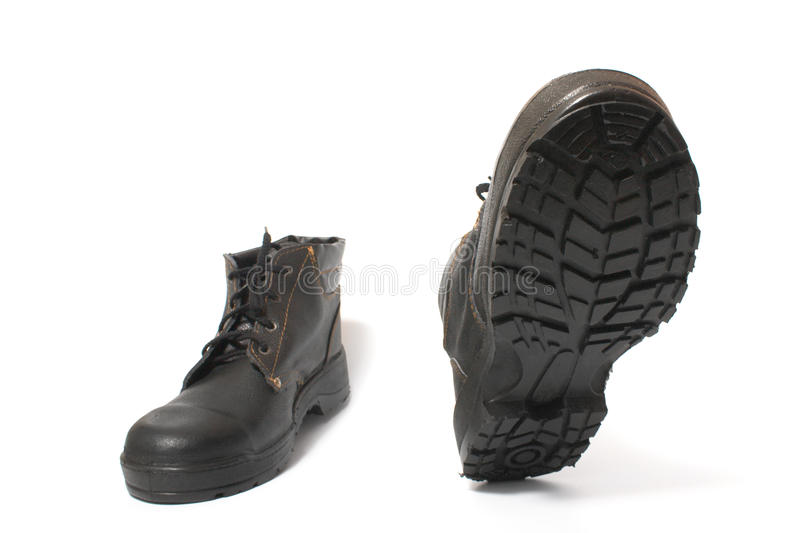 Walking black boots. Walking black work boots isolated on white background stock photos