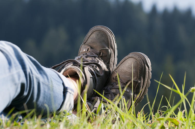 Walking boots. On meadow in landscape royalty free stock photo