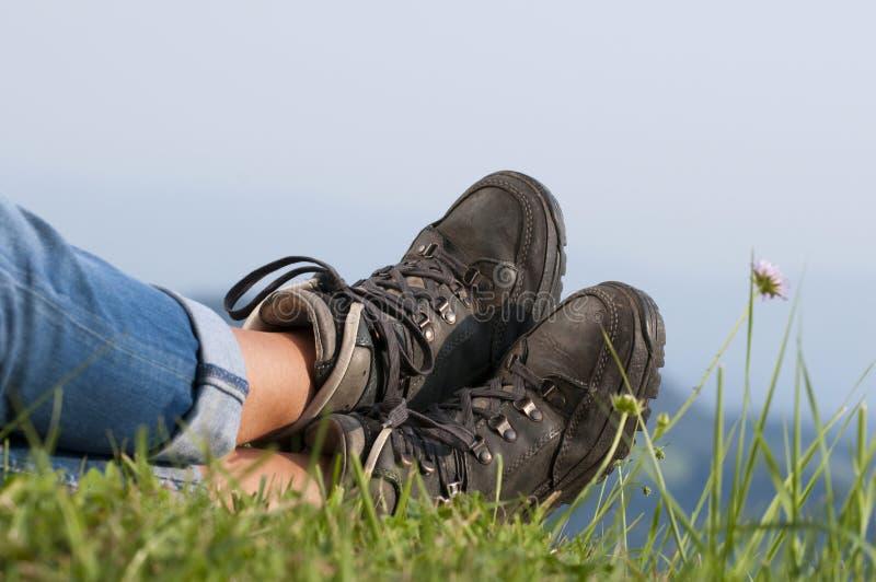 Walking boots. On meadow in landscape stock image