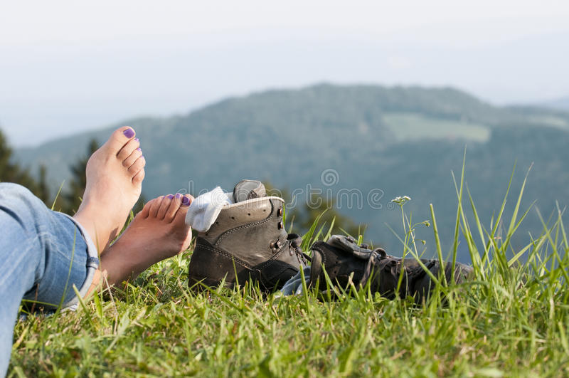 Walking boots. On meadow in landscape stock photography