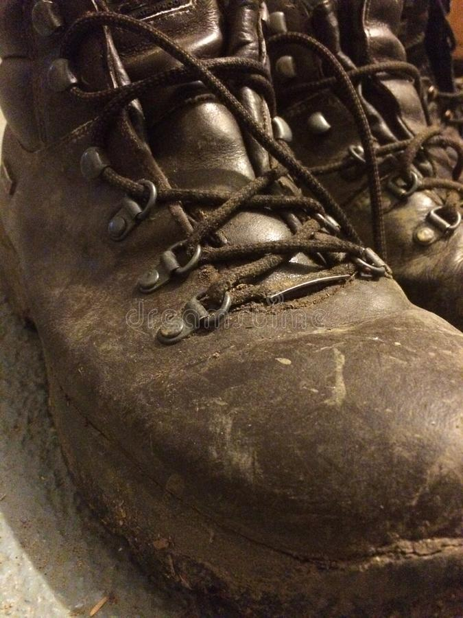 Walking Boots. Muddy walking boots after a long hike stock photo