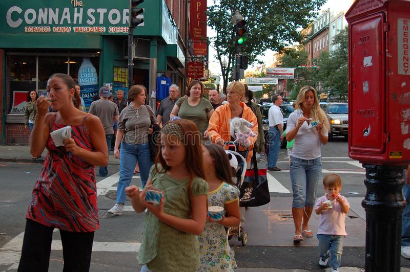 Walking in Boston`s North End. Families enjoy some treats while walking amongst the businesses in Boston`s North End royalty free stock photos