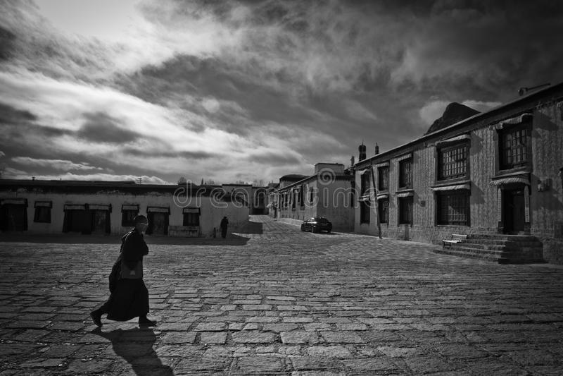 A walking Buddhist monk of Tashilompu Monastery Shigaste Tibet royalty free stock photo