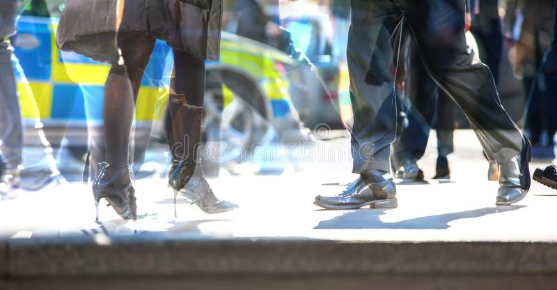 Multiple exposure image of walking people in London. Business concept illustration. stock photos
