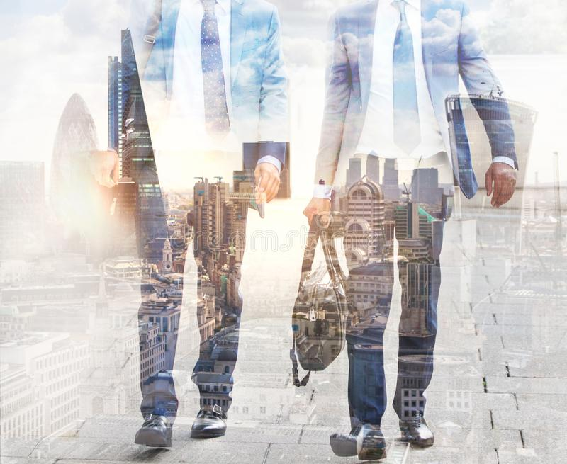 Multiple exposure image of walking people in London. Business concept illustration. stock photo