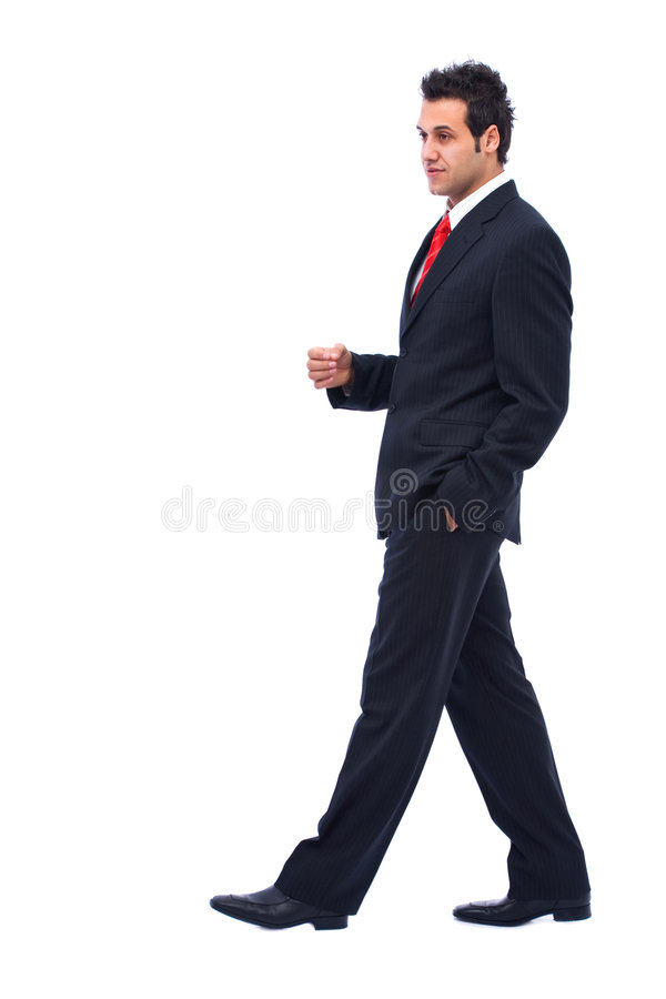 Walking businessman. Young and walking businessman portrait on white background royalty free stock images