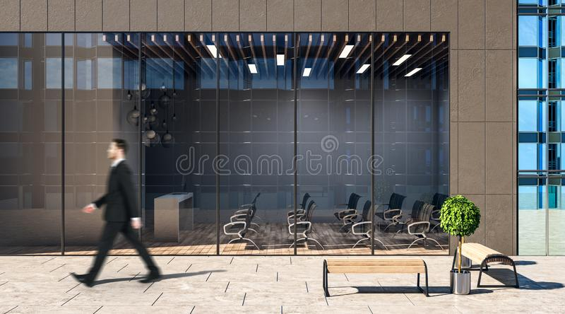Walking businessman at modern workshop auditorium background royalty free stock photos