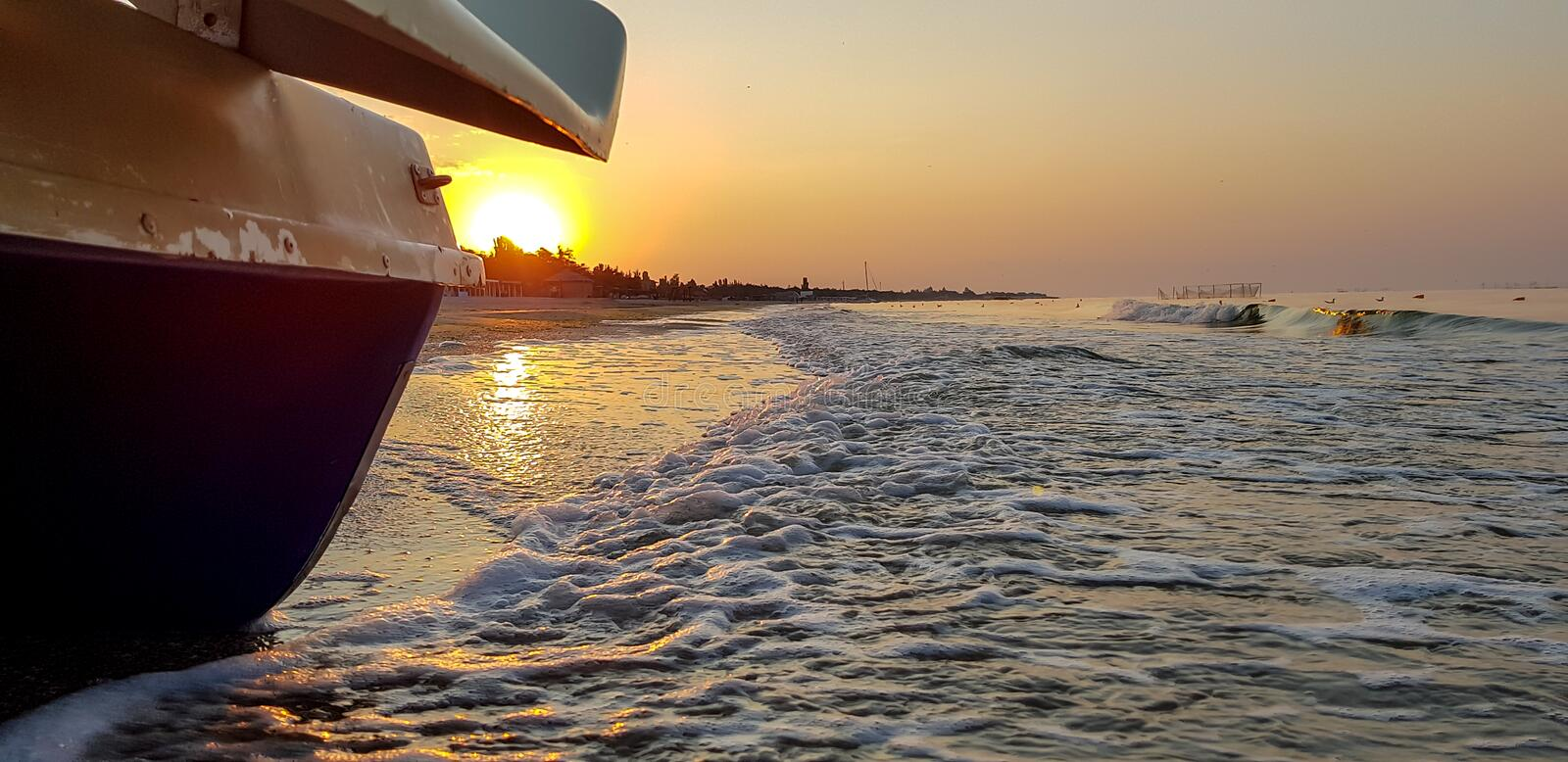 Walking catamaran against the backdrop of sunrise on the sea. royalty free stock images