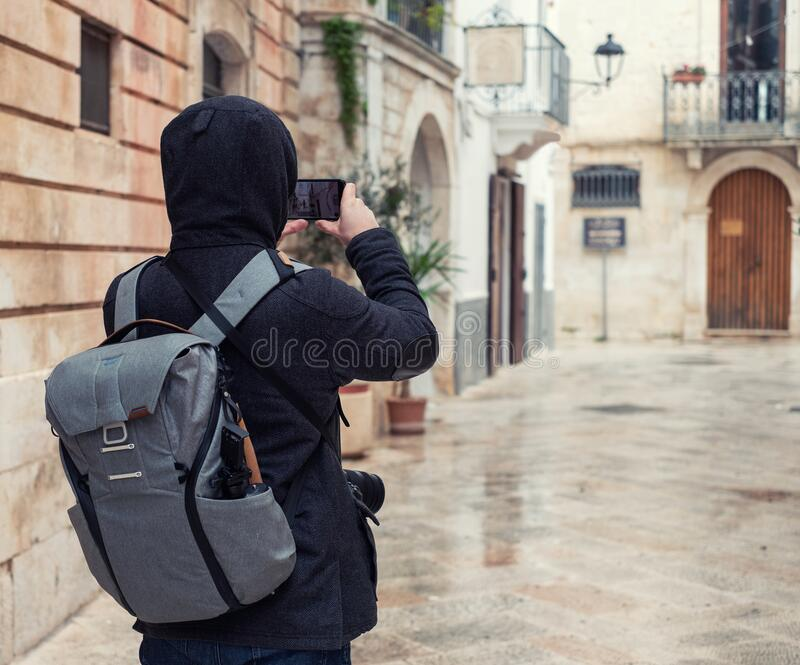 Photographer taking pictures of charming white streets in Locorotondo, Italy royalty free stock photo