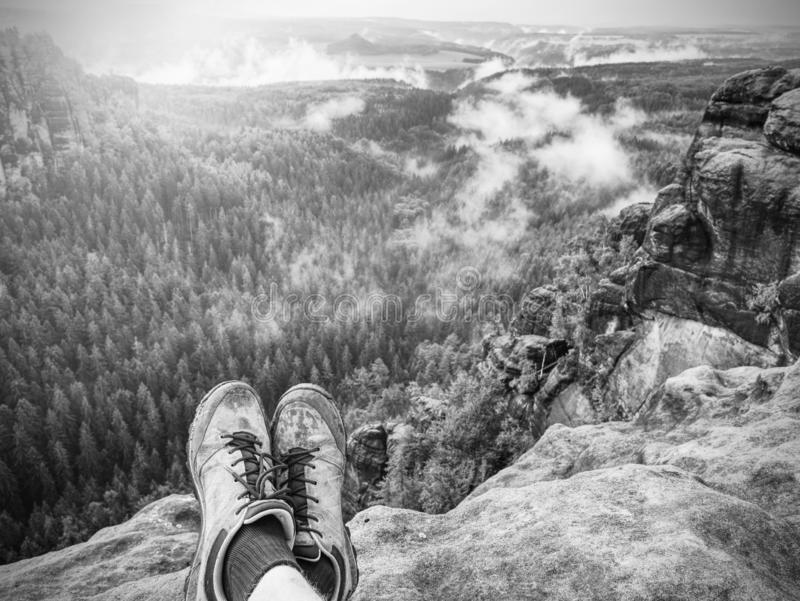 Walking comfortable shoes. All terrain shoes. Hiking boots on hiker. Outdoors walking crossing rocky traail. Fall hike in pure nature royalty free stock image