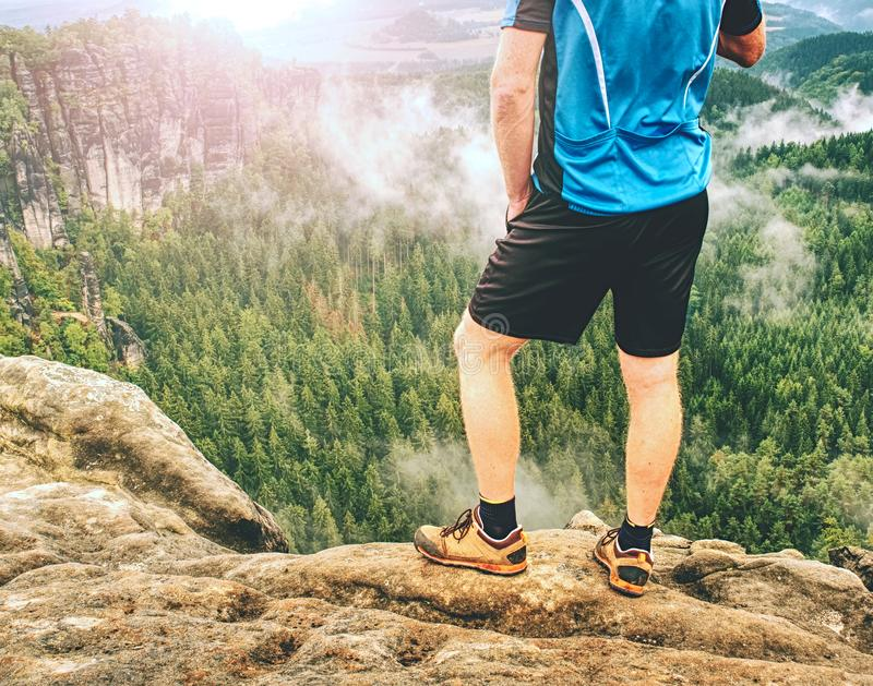 Walking comfortable shoes. All terrain shoes. Hiking boots on hiker. Outdoors walking crossing rocky traail. Fall hike in pure nature royalty free stock photography