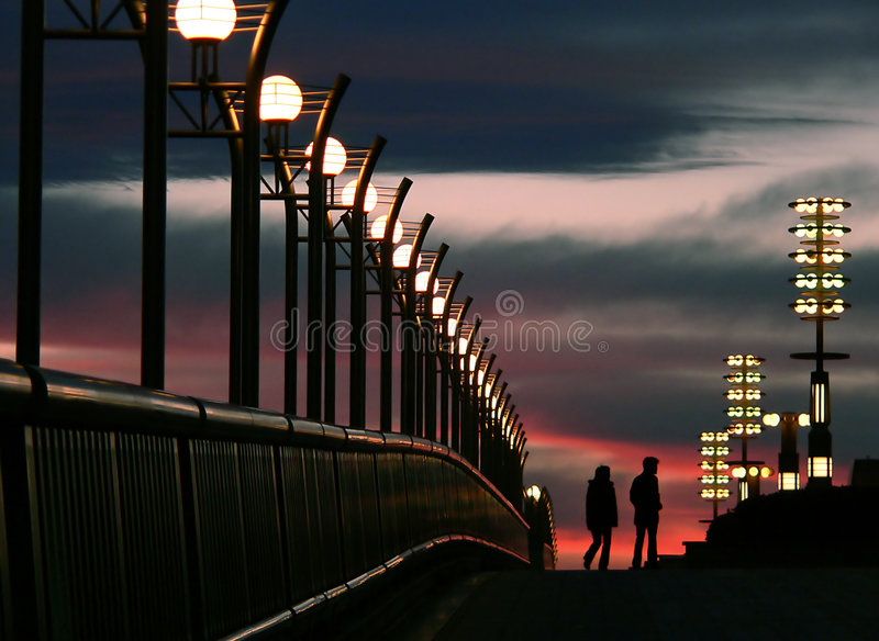 Walking couple and evening sky royalty free stock images