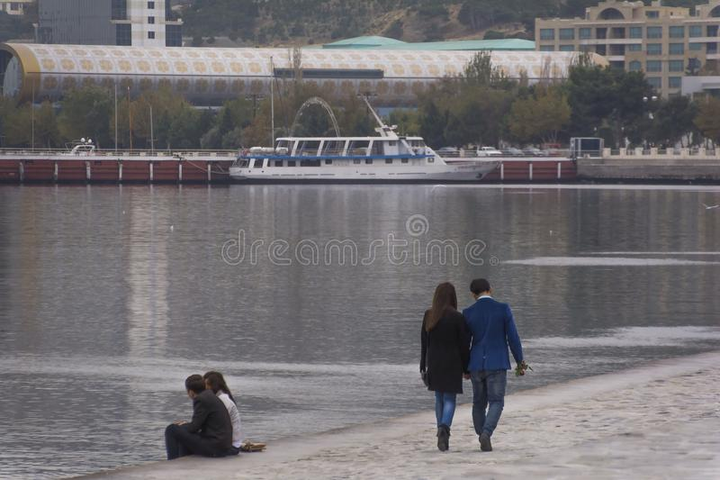 Walking couple. Couple walks on the boulevard royalty free stock photos