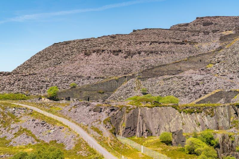 Dinorwic Quarry, near Llanberis, Gwynedd, Wales, UK. Walking in the derelict Dinorwic Quarry near Llanberis, Gwynedd, Wales, UK stock photo