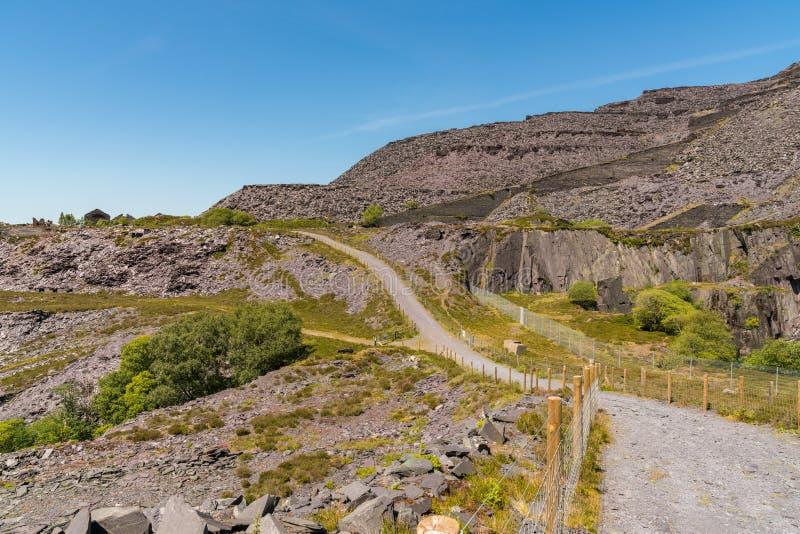 Dinorwic Quarry, near Llanberis, Gwynedd, Wales, UK. Walking in the derelict Dinorwic Quarry near Llanberis, Gwynedd, Wales, UK stock image