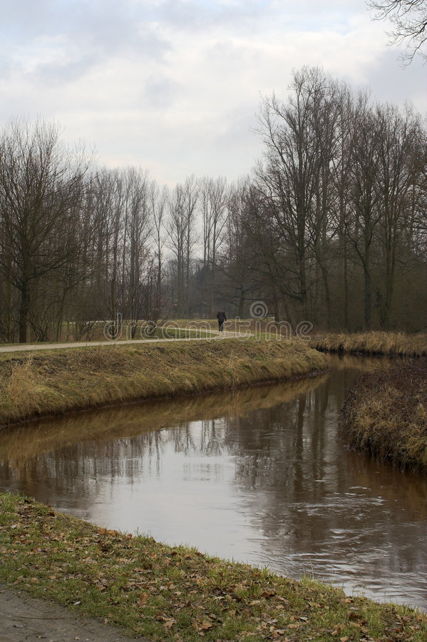 Download Walking The Dog Along The Bank Of A Curvy River Royalty Free Stock Photos - Image: 515068