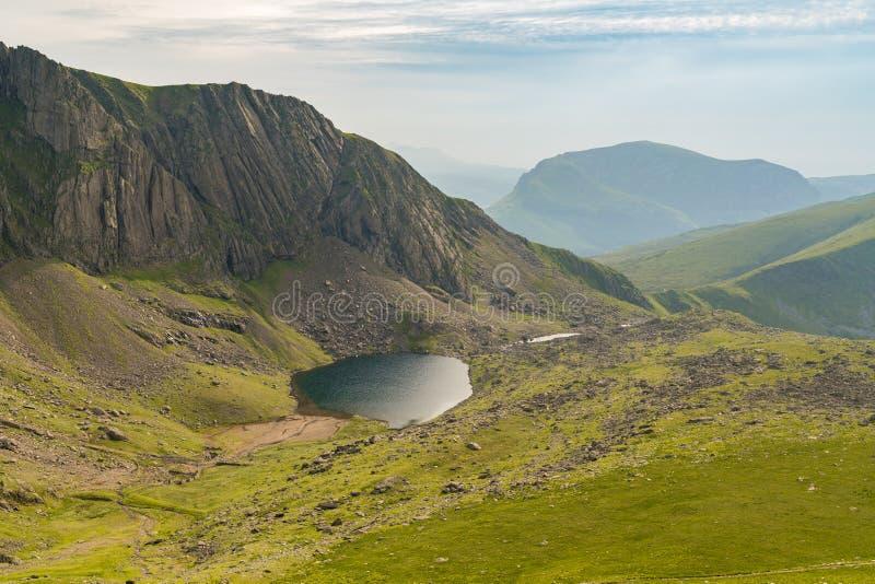 Llanberis Path, between Mount Snowdon and Llanberis, Gwynedd, Wales, UK. Walking down from Mount Snowdon on the Llanberis Path, Snowdonia, Gwynedd, Wales, UK stock photos