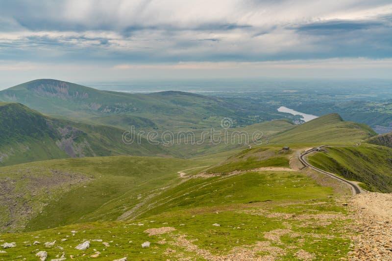 Llanberis Path, between Mount Snowdon and Llanberis, Gwynedd, Wales, UK. Walking down from Mount Snowdon on the Llanberis Path, Snowdonia, Gwynedd, Wales, UK stock photography