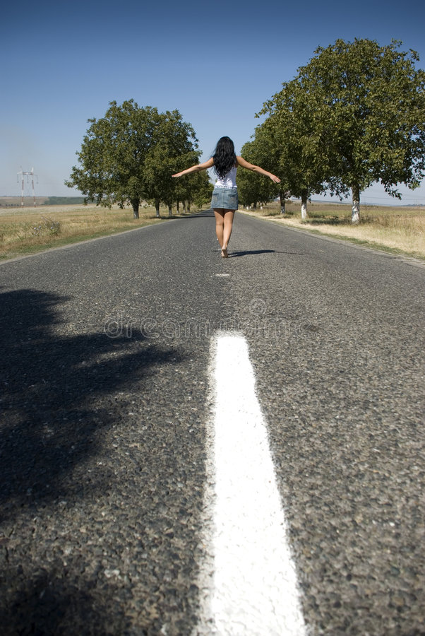 Walking on empty road royalty free stock images