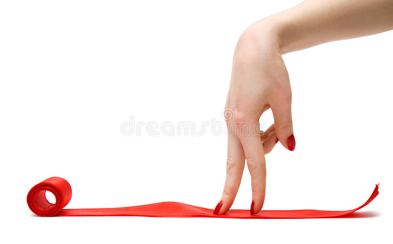 Walking fingers on a red ribbon. Isolated on white stock images