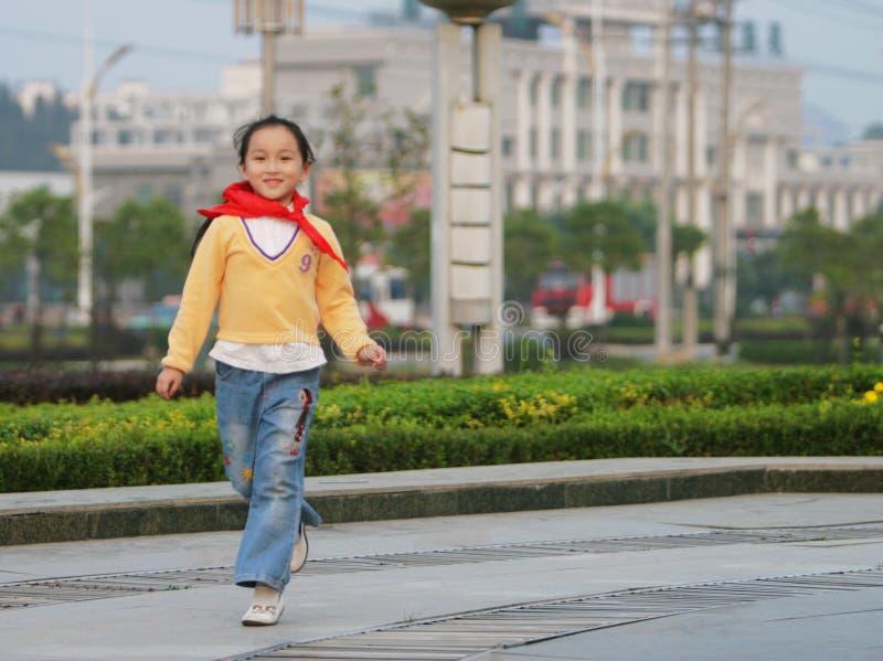 Walking girl stock photo