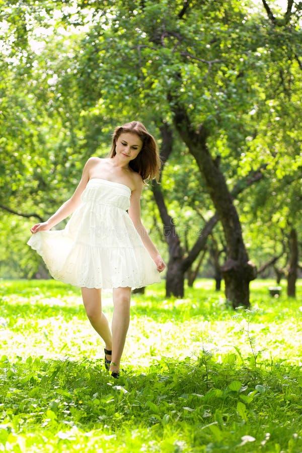 Walking girl in white dress stock images