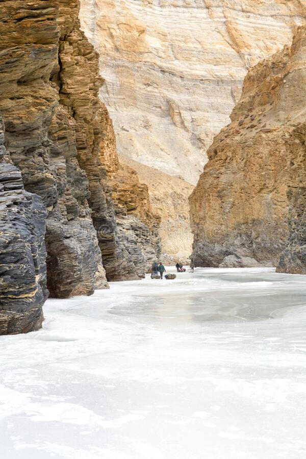 Walking through a gorge on the frozen Zanskar River. One of the most adventurous treks in the world. Winter trek concept image stock photos