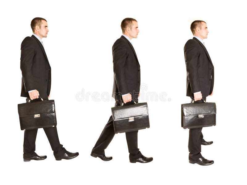 Walking handsome businessman. royalty free stock photos
