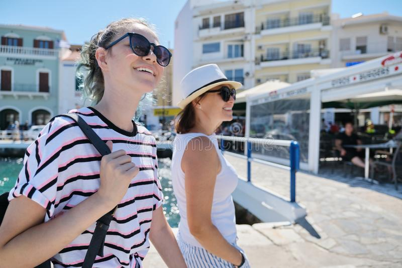 Walking happy mother parent and teenage daughter summer holidays together royalty free stock images