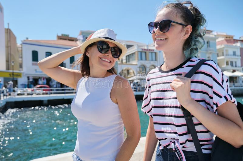 Walking happy mother parent and teenage daughter summer holidays together royalty free stock photos